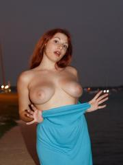 Busty redhead Gina Rosini exposes her big natural tits in public
