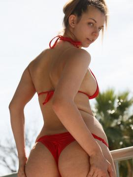 Hot coed Zoey Lee teasing in and out of a bikini in Red Hot Arizona